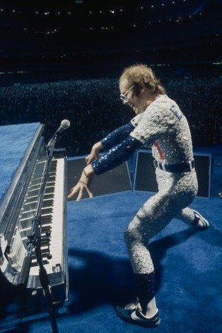 Elton John height and weight