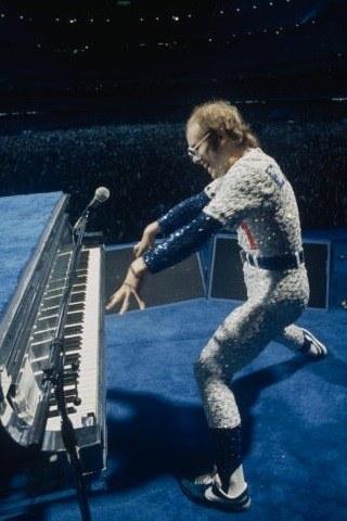 Elton John height and weight
